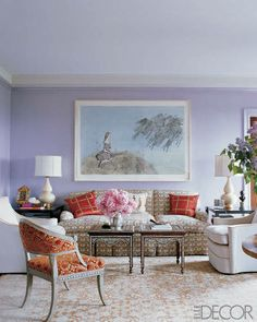 Elegant & Eclectic Sitting Area Soothing lavender walls offset ornately patterned furniture. Ridder layered this opulent living room with rich decor — a pair of inlaid Indian tables, a sofa upholstered in a linen weave, an antique Tabriz carpet, a Kiki Smith painting — for a modern-regal effect.