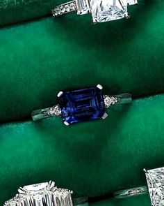 PERFECT RING, Sapphire, Rectangle Cut Sideways, diamonds on the side get smaller as they move away from Sapphire