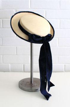 Vintage 1950s Cream Straw Blue Velvet Madeline Hat. $20.00, via Etsy.