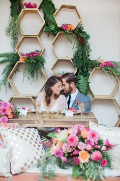 10 Unique Statement Walls for Your Wedding Decor | Forget the wedding arch. The unconventional bride has her eyes set on this stylish hexagonal pattern display with romantic floral arrangements.