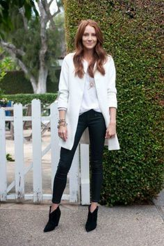 White jacket, white blouse, lavaliere necklace, black pants