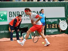 Roger Federer hits a tweener RG14  Photo credit: Peter Staples