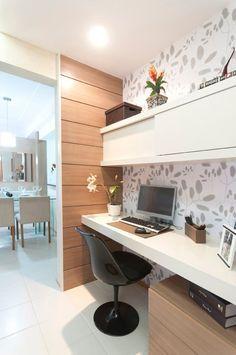Usa uma parede, uma mesa lisa, gavetas com rodízio, prateleira, papel parede.
