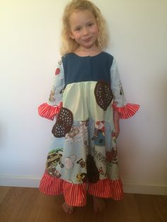 "Girls dress made of used beddings and with crocheted ""pancakes""."
