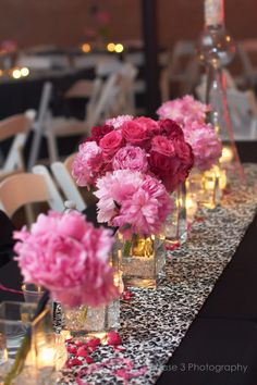 like the pink flowers with the black and white table runner