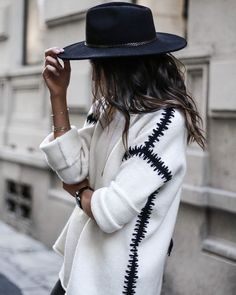 Really love everything about this sweater, especially the the black weaving