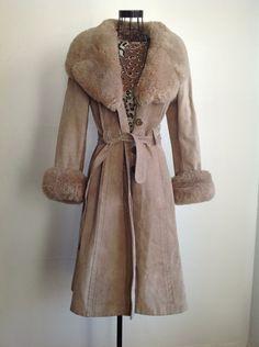 vintage shearling trimmed suede leather coat winter wondeland jacket 70s overcoat. $50.00, via Etsy.