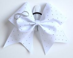 I absolutly love this bow.something about white bows i love and a plus has the infinity sign