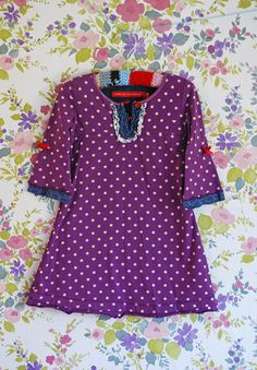 I love this little dress.  Indigo would look so cute in it.