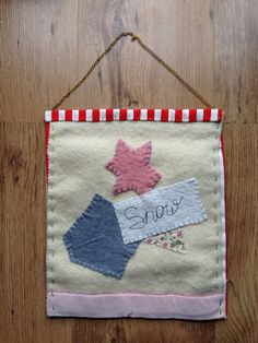 Small textile wall hanging made from vintage blanket, appliqué, patches