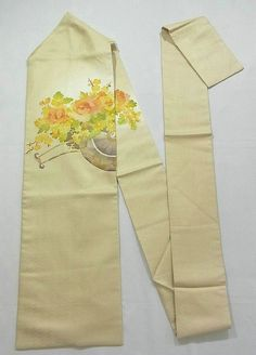This is a graceful Shioze Nagoya obi with flower cart design such as 'botan'(peony), 'kiku'(chrysanthemum) and 'ume'(Japanese plum), which is dyed