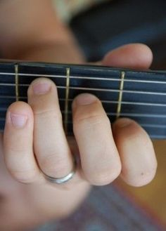How to play just two chords on a guitar, so you can sing ten songs with the kids. Photos and tutorial linked.