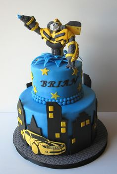 Transformer cake - BumbleBee for my neighbor's son. All fondant / fondant+tylose except for BumbleBee's support. Chocolate mud cake with ganache. Bumble Bee Transformer Cake, Transformer Birthday, Fancy Cakes, Cute Cakes, Iron Man Kuchen, Cake Cookies, Cupcake Cakes, Building Cake, Birthday Cakes