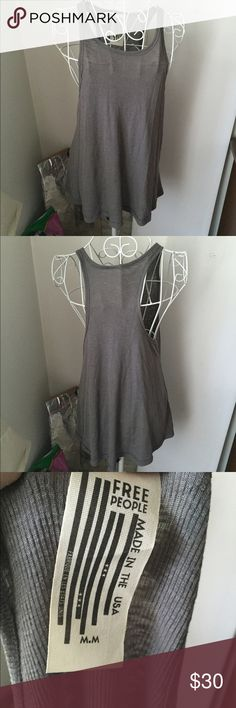 Free People tank condition as shown and reflected in price. This item is in good condition but it has been worn please ask any questions before purchasing. This item will only be traded for an autographed Authentic Chanel original, a Lamborghini, a penthouse in Paris, or the services of an Audi mechanic. All orders will be recorded before shipping. I do not model. Please see my reasonable offer chart before submitting an offer. Free People Tops Tank Tops
