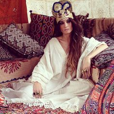 Madame de Rosa in a white flowy dress and headpiece