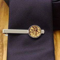 Hey, I found this really awesome Etsy listing at https://www.etsy.com/listing/211834424/wooden-globe-tie-clip
