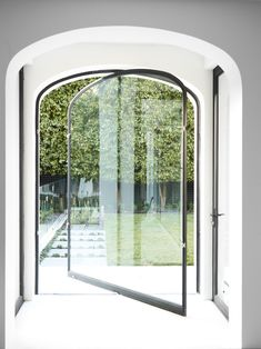 Arched pivot glass door