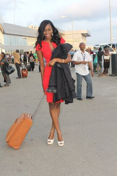 Stephanie Okwu in red gown at the airport