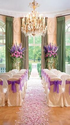 Inspiration for the isle (cream with purple accents). Love the chandelier and floor to ceiling green curtains. weddingchair