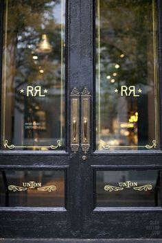 Gold window decals, store sign on doors