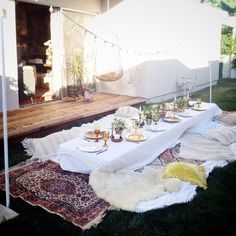 Dinner Party | blankets and cushions for ground level seating