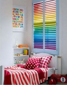 How cute would that be in the kids room!? Only I wouldnt put it over the regular window. Id buy a shutter, paint it like this, mount it on another wall and put christmas lights behind it.