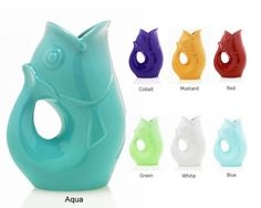 gurgle fish pitcher! THIS is what I want!  It is at that awesome gift shop? Biscotti's on Youree in Shreveport.  I want in aqua or orange!