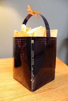 Our ever-crafty designer, Courtney Foat, created this gift basket from recycled microfiche. Could start a trend...