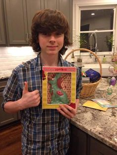 Carl Grimes from The Walking Dead is constantly missing, but a few days ago he could be found posing with a chocolate zombie bunny. Chandler Riggs posed with the gross looking Easter treat, and it's all too appropriate.  April 2014 #TheWalkingDead