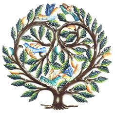 This 24 inch Haitian metal wall art features a tree of life with birds in a heart shape. Perfect for hanging indoors or out, the piece is hand painted, hand cut and embossed. Meet the Artisans When yo