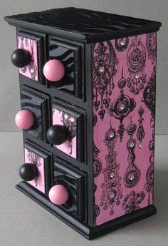Decoupaged and hand painted inside and out this piece is just too funky and whimsical. I am so happy with the it turned out. Done in a black flocked zebra and pink and black gem print outside. Inside drawers are also finished. MEMBER - FunkyArt08