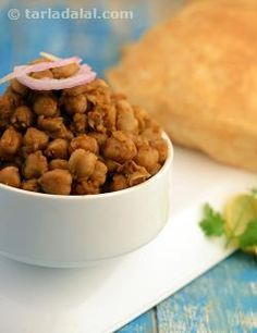 """My earliest memories of Chole Bhature is of the one I ate at a popular eatery in   Mumbai Known as """"Cream Centre"""". On enquiring, I was told that the chick peas and spices were simmered together for hours resulting in a dish that a large number of Mumbaites relish even today!  My version of chole is however, ready in minutes and is as delicious. I have also   added tea leaves, which impart a dark brown colour to the chick peas which usually comes from simmering chick peas in an iron pot.  I…"""
