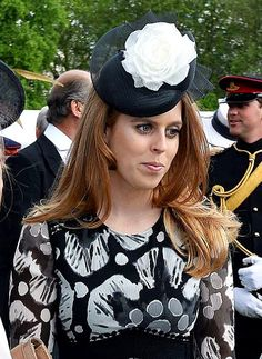 Princess Beatrice, May 24, 2016 in Nerida Fraiman | Royal Hats: Princess Beatrice's hat features a black beret base with twisting black crin brim that looked to end in a pleated fan at the back. The design is completed with a white silk rose which tied the piece nicely with Beatrice's black and white dress.