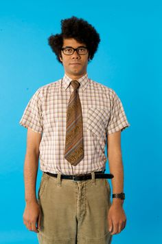 Moss from The IT Crowd. Oh my goodness the side-parted afro.