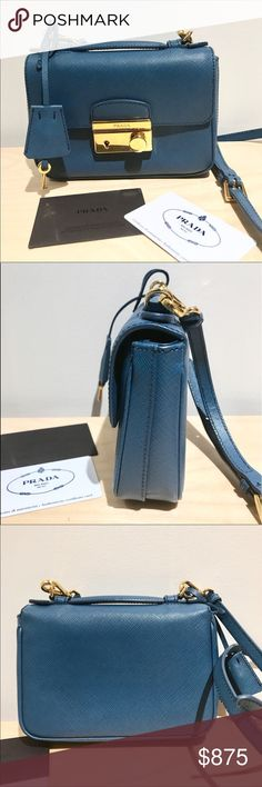 """Authentic Prada Saffiano Mini Sound Crossbody Bag This is authentic brand new condition Prada Saffiano Mini Sound Crossbody bag in Blue (Cobalto) color. It has Saffiano leather with golden hardware. Comes with authenticity card and 2 keys for the lock 🔐  - Top handle; detachable crossbody strap. - Flap front with engraved push-lock. - Inside, napa lining and zip pocket. - Approx: 4 1/4""""H x 6 3/4""""W x 1 1/2""""D. - Made in Italy. Prada Bags Crossbody Bags"""