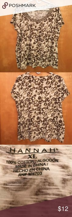 """HANNAH LEOPARD PRINT Short Sleeve BLOUSE 🌺 LOOKS SUPER COMFY.....HANNAH Leopard print tee.  Short sleeves with braided weave around front neckline.  100% cotton Details:  machine wash cold, gentle cycle.  Tumble dry low, remove promptly.  Measures:  chest 22"""", length 26"""".  Perfect Condition!!  Stored in a smoke free home. Hannah Tops Tees - Short Sleeve"""