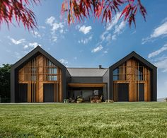 All Black House Design Of Three Gabled Volumes