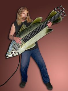 """While searching for """"bass guitars"""" on here, I came across this. That looks eerily similar to the singer from Nickelback. And this bass is shaped like a fish, if you didn't notice."""