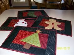 Christmas placemats @Annie Compean Reed.. these would be cute with a name embroidered on each!!