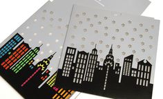 printinspired:    If you pull the insert of this card up, the printed color on the inside highlights the laser cut details of the skyline and snowflakes. This Skyline Laser Cut Greeting Card is from www.lasx.com