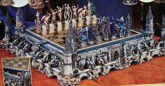 """Fantasy Gothic Chess Set by Franklin Mint, 1994. Hand-painted Pewter. Signed M. Whelan. Castle 22"""" x 22"""". The chessboard is 12"""" square. King 3-1/2"""" tall."""