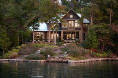 source May I share my lake house love with you one more time? I can't promise this will be the last time either. Sorry. :( You see, I found this gorgeous lake house on Lake Burton (in north Georgia) that you just have to see. It had me at its stairway by the front door.Hello beautiful…