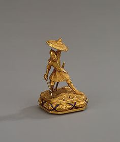 Table Seal Shaped like the Figure of a Russian Warrior  Heliotrope and gold; cast, chased and carved. 3.7x2.3x2.5 cm  Arndt, Samuel. Firm 'Angliysky Magazin' (English Shop)  Russia. St Petersburg. 1850s