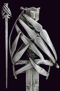 Schiavona Sword  Dated: 17th Century Culture: Italian, Venetian Place of origin: Venice Measurements: 115.5cm The sword has a straight, double-edged bade of hexagonal section, slightly grooved and engraved at the first part. It also has an iron cage-hilt and pommel.