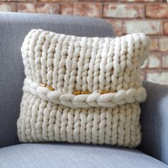 Hartland Cushion, hand knitted and finished with wooden toggles