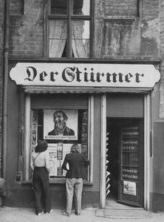 The offices of the Nazi newspaper Der Stürmer in the Free City of Danzig, circa 1935. The anti-Semitic poster in the window reads 'Die Juden sind unser Unglück!' (The Jews are our misfortune!).