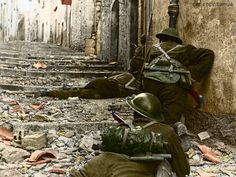 4 Over the body of a dead comrade, Canadian infantrymen advance cautiously up a narrow lane in Campochiaro, Italy, on Nov. The Germans left the town as the Canadians advanced, leaving only nests of snipers to delay the progress. Canadian Soldiers, Canadian Army, British Army, British Soldier, Colorized Photos, Ww2 Photos, Photographs, Martin Luther King, Battle Of Moscow
