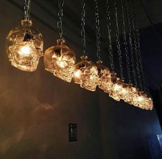 Crystal skull vodka bottles made into lights. - Sweet baby Jeebus. I'd be drunk from now until 2018 if I had to drink enough vodka to make all those lights! More