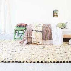 Lar-a. Sage x Clare bedding and carpet