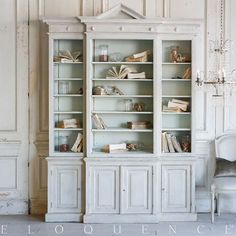 Stately large antique cabinet in Light Stone distressed finish and Pale Duck Egg interior. This case piece has a plethora of shelves for easy storage to hold books or display items. Angular geometrics dominate the look of this stately cabinet which adds country charm to a kitchen or a bedroom.   99H x 5W x 21D